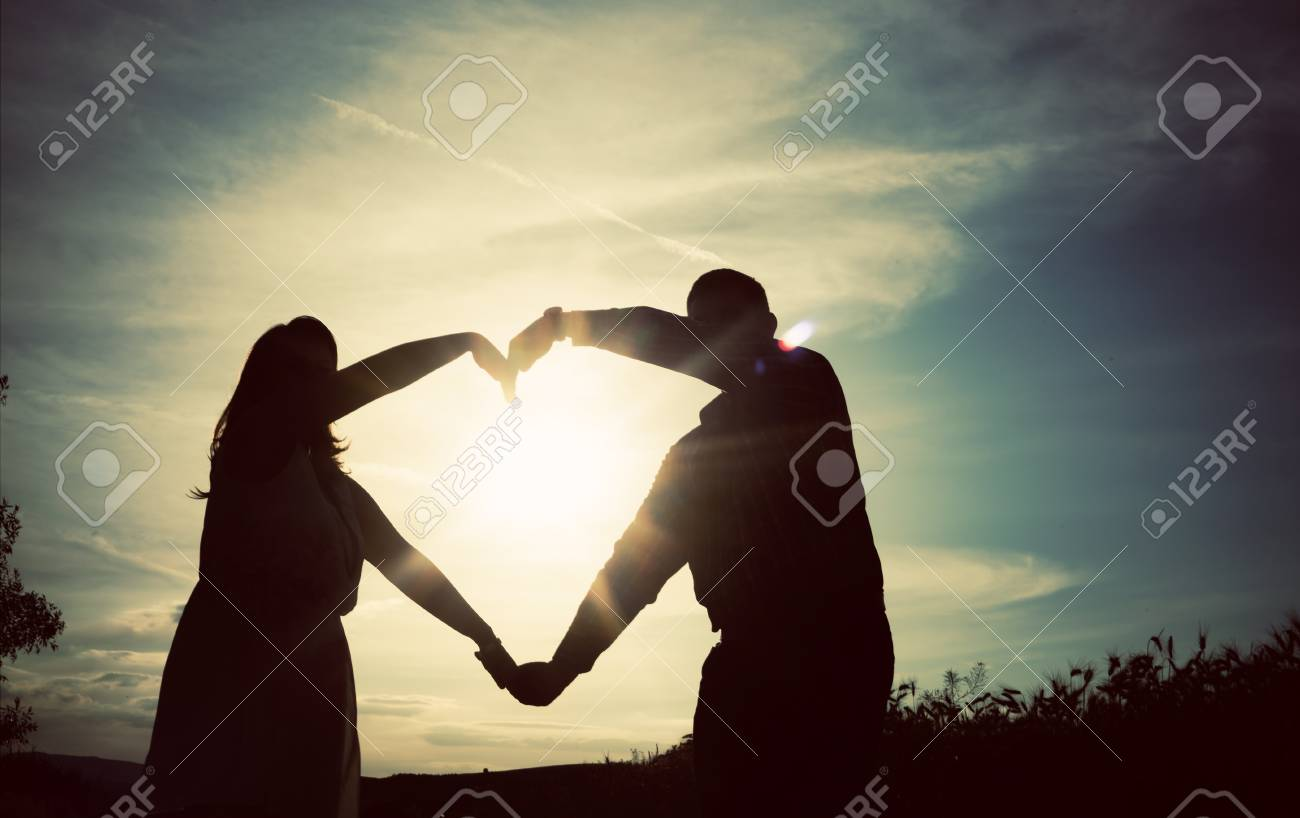 Silhouette Of Loving Couple Holding Hands In Heart Shape Over ... for Couple Holding Hands Silhouette Sunset  146hul
