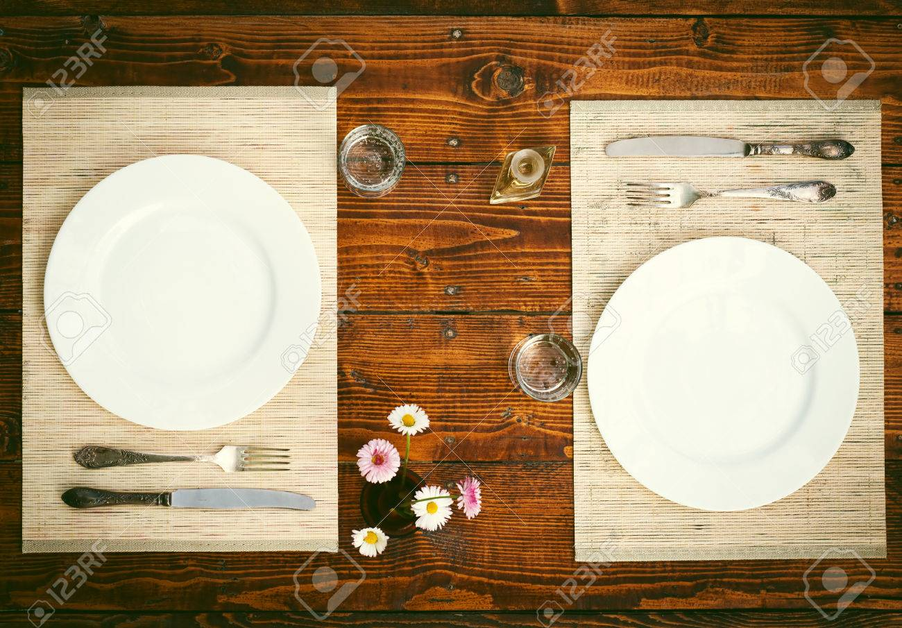 Table setting for two with empty plates - rustic wooden table - 40213901