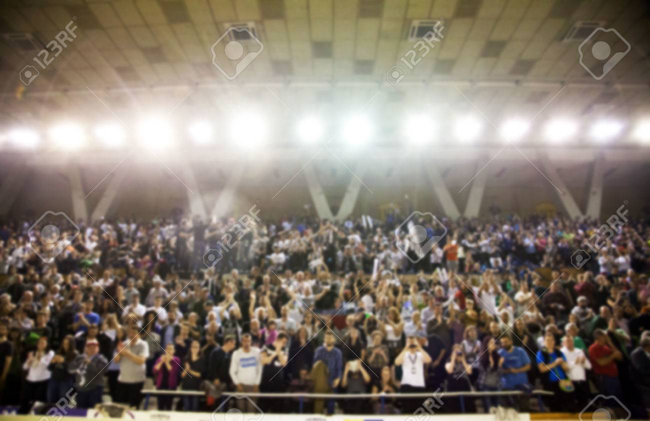 Blurred background of crowd of people in a basketball court - 59467573