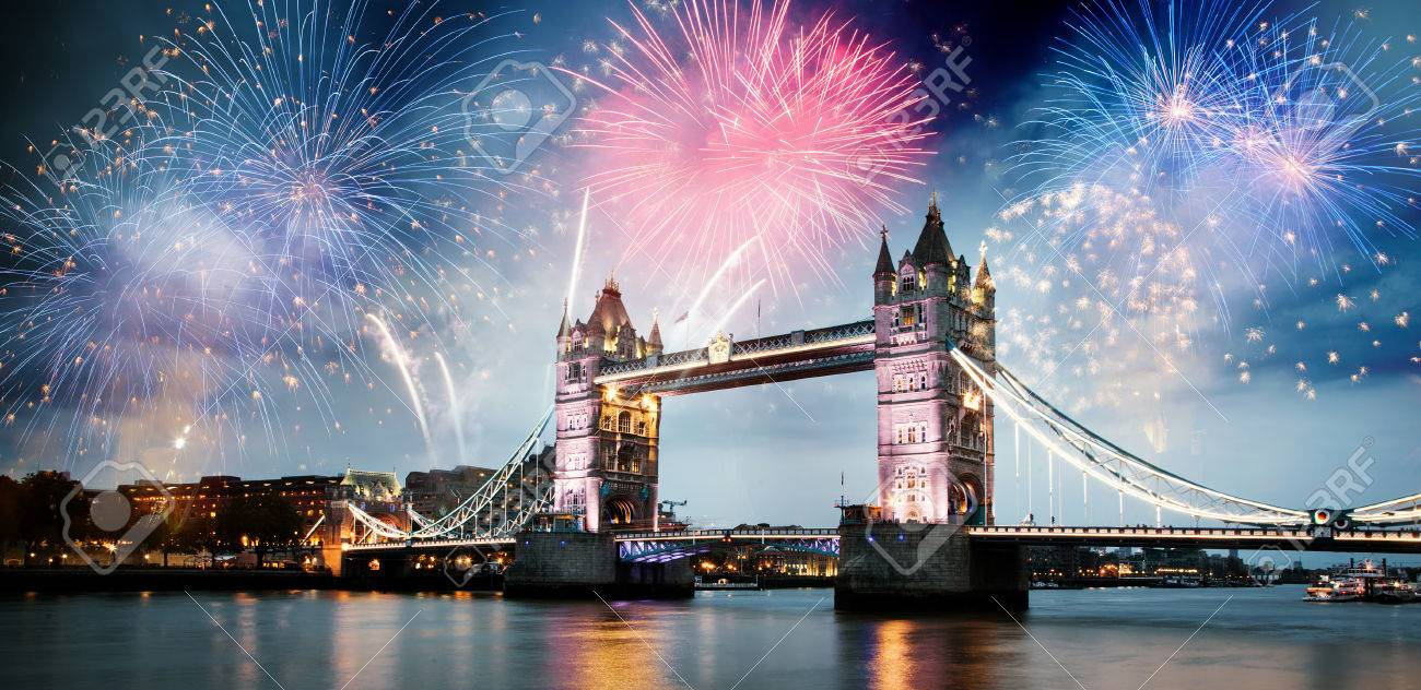 fireworks over the River Thames in London - celebrating New Year in the city - 65085462