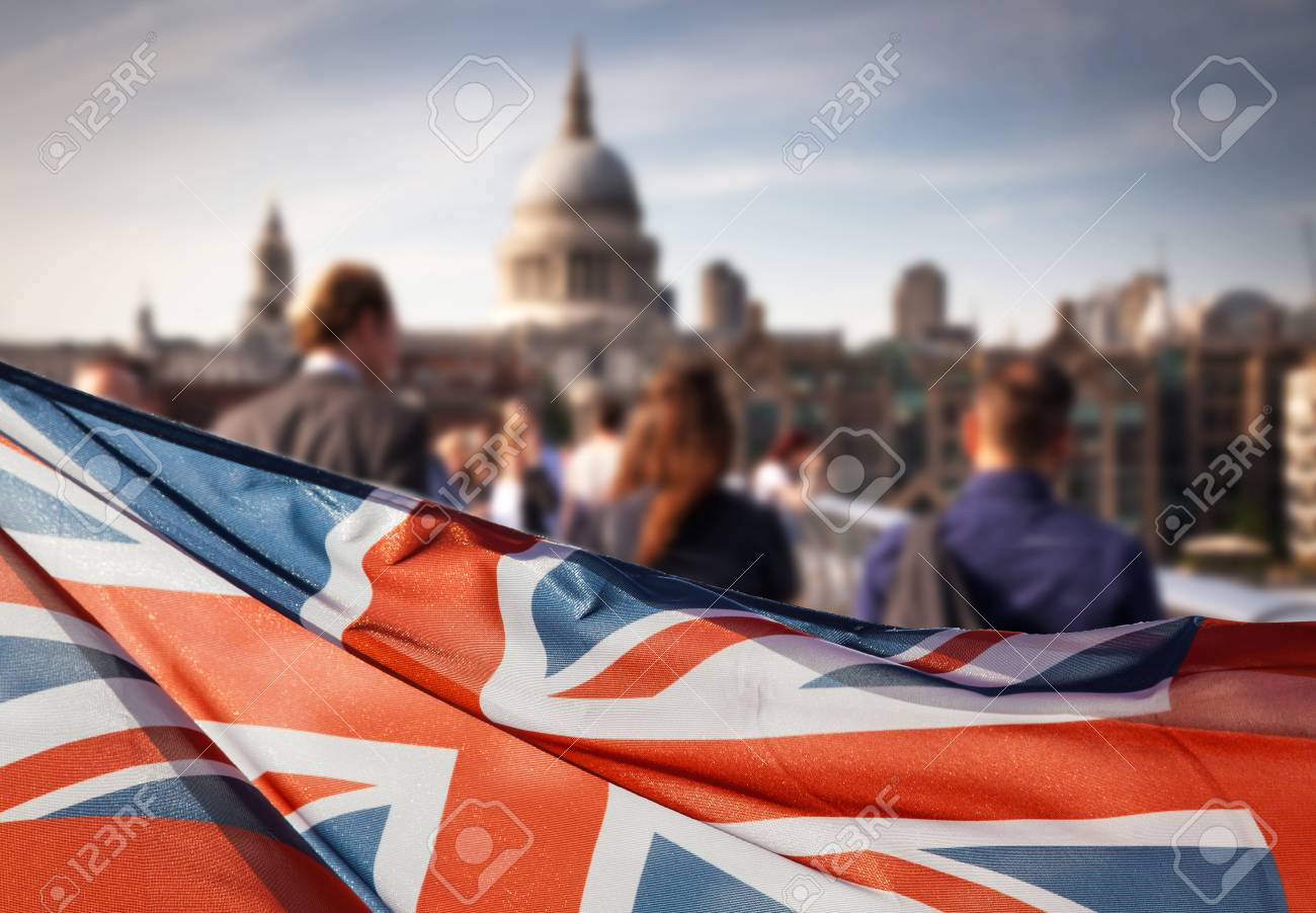 union jack flag and people walking on Millennium bridge at St Paul's cathedral - general elections, London, UK - 80016484