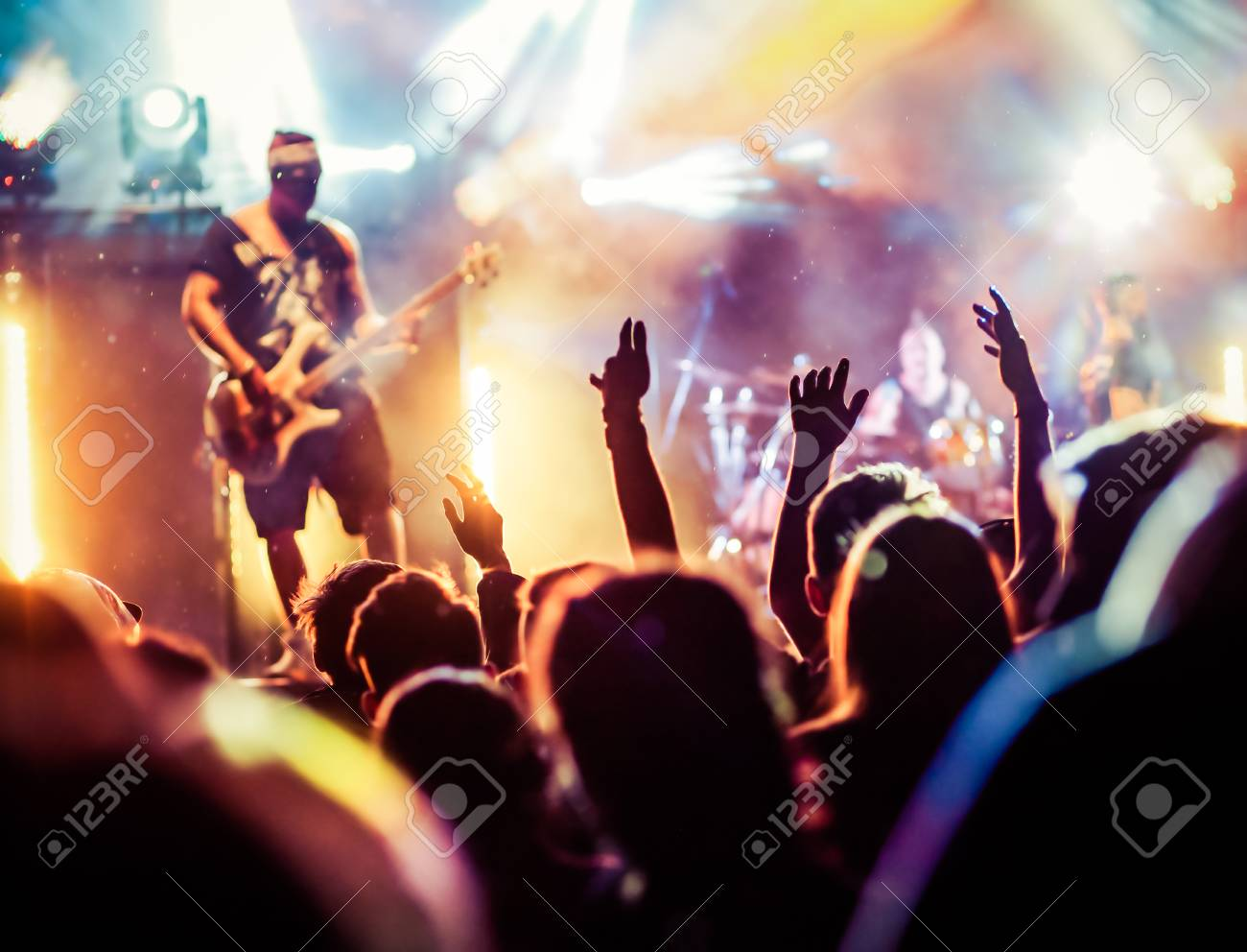 crowd with raised hands at concert - summer music festival - 82673098