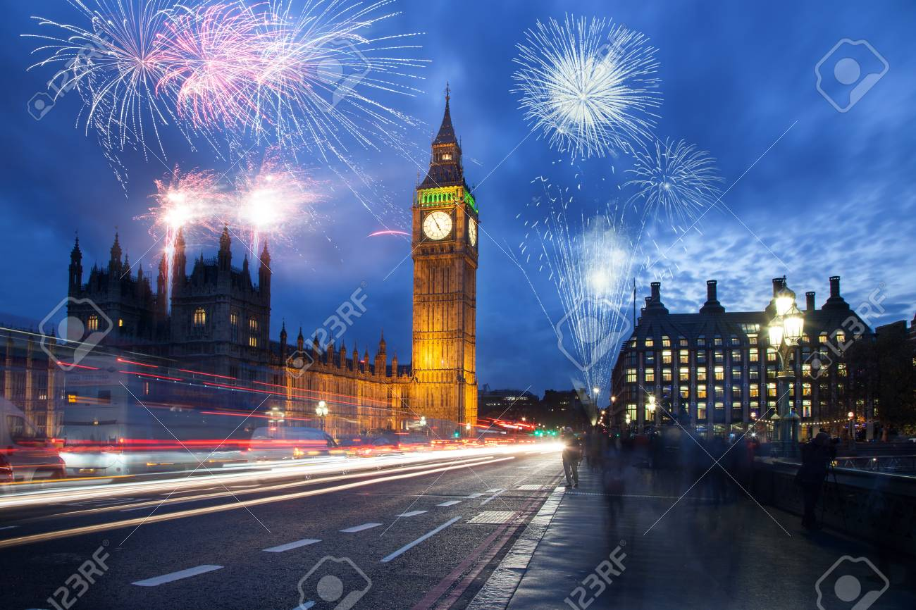 explosive fireworks display fills the sky around Big Ben. New Year's Eve celebration in the city - 90961630