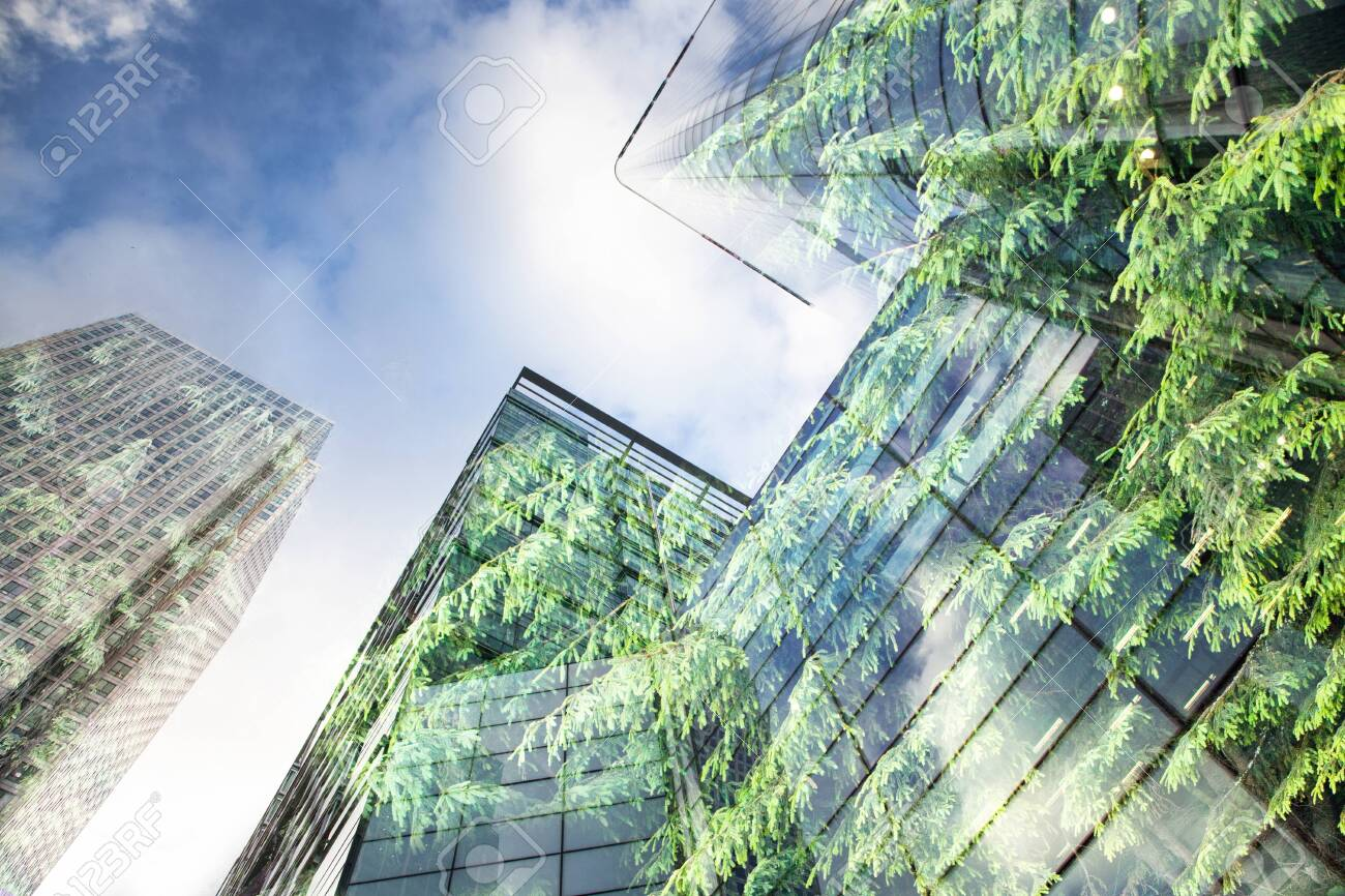 green city - double exposure of lush green forest and modern skyscrapers windows - 121283873