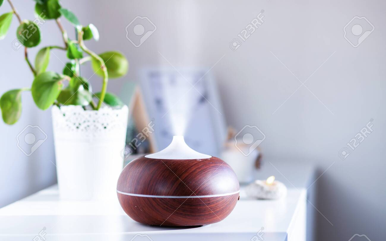 Aroma Oil Diffuser On Table At Home Air Freshener Stock Photo Picture And Royalty Free Image Image 128117267