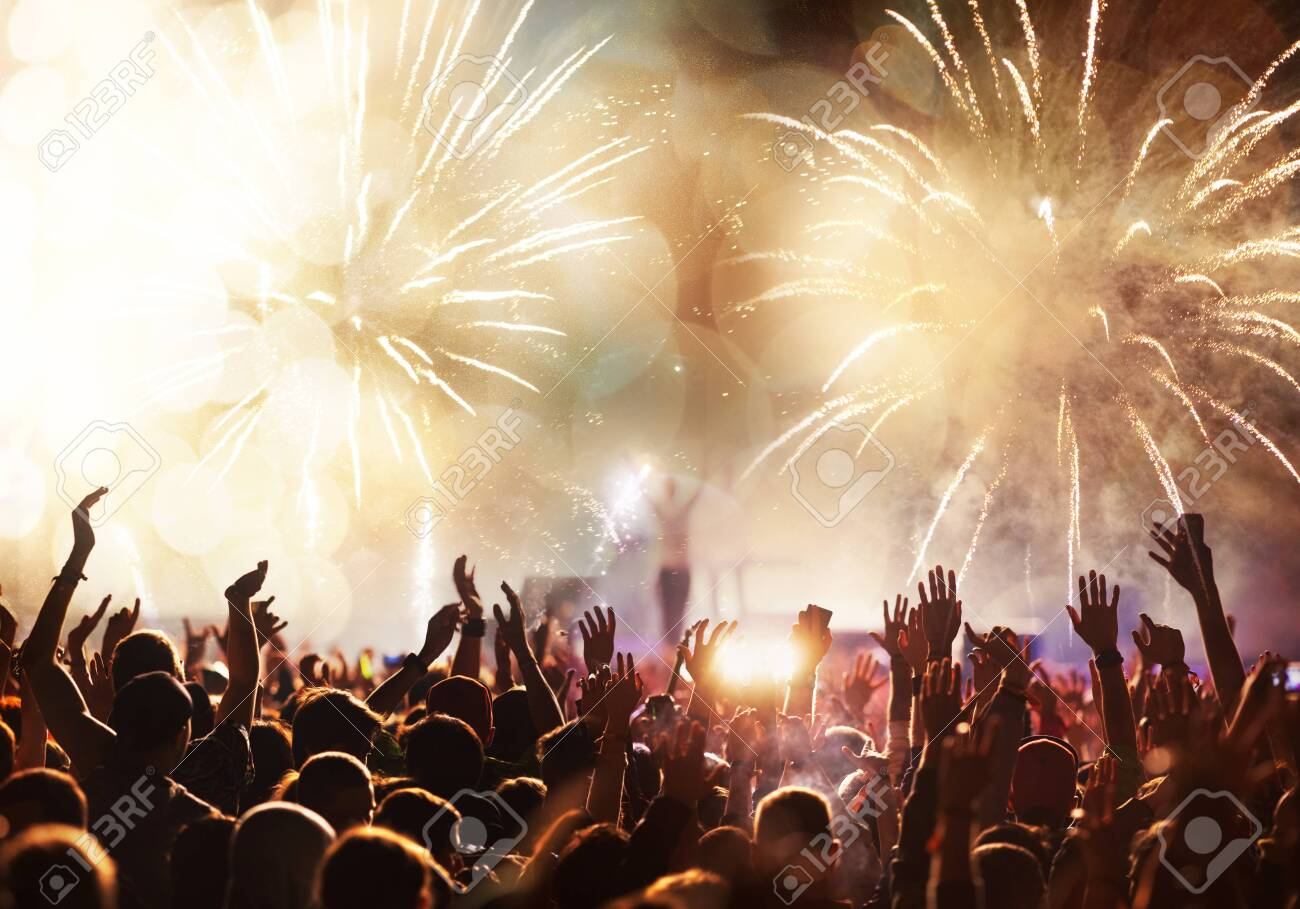 crowd with raised hands and fireworks new year banner - 136357250