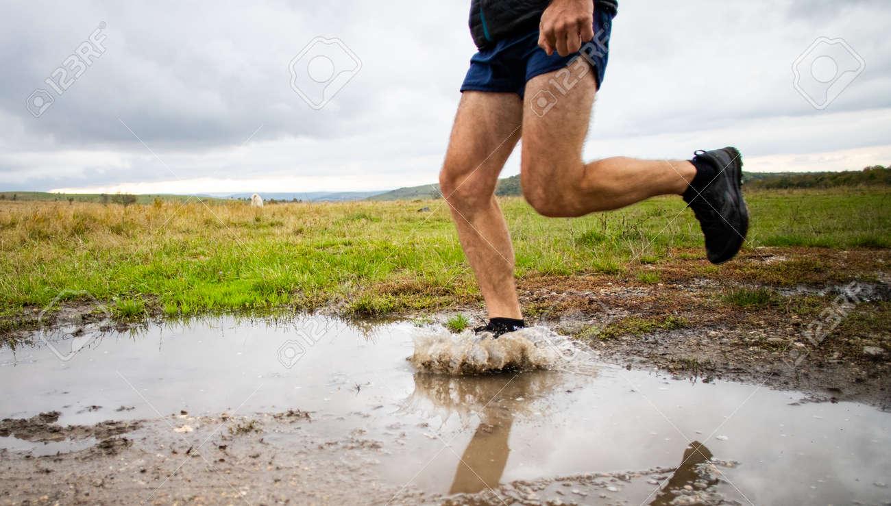 feet of trail runner running in nature - 157658496
