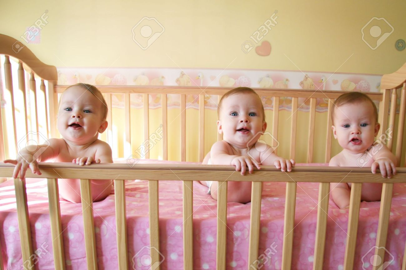 Crib for triplet babies - Stock Photo Triplet Little Baby Girls In Crib
