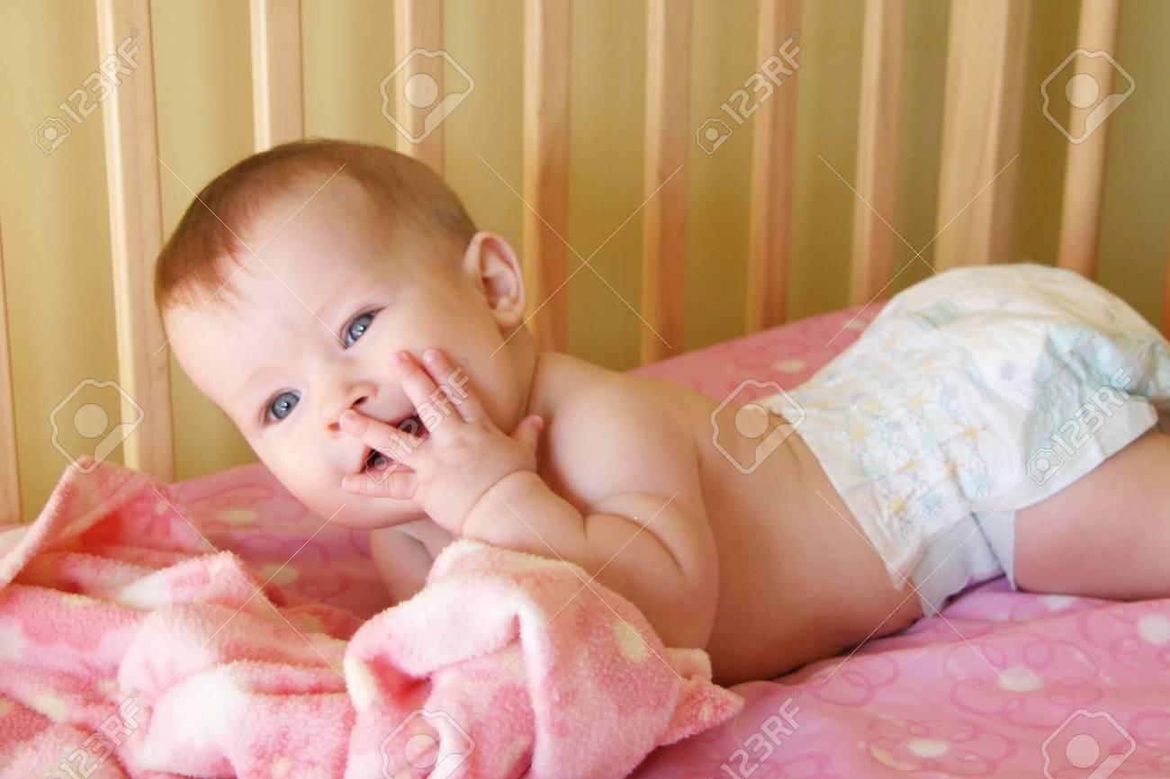 Little Baby Girl in crib - 580867