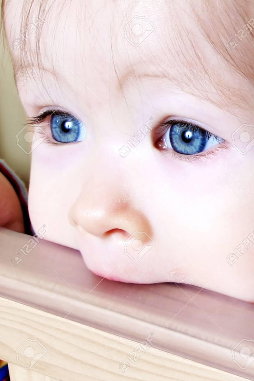 Little Baby biting on crib, taken closeup - 775445