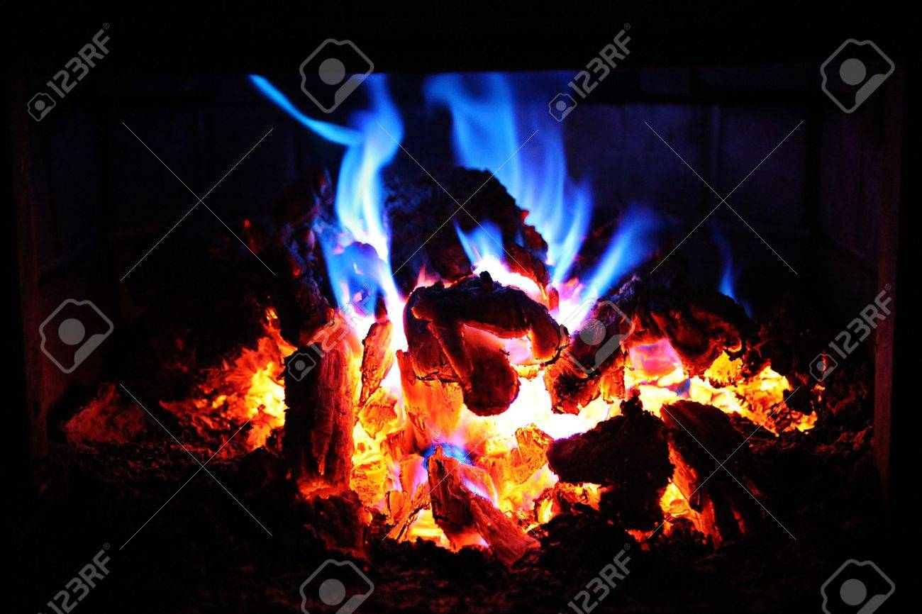 fire in fireplace with red and blue flames stock photo picture
