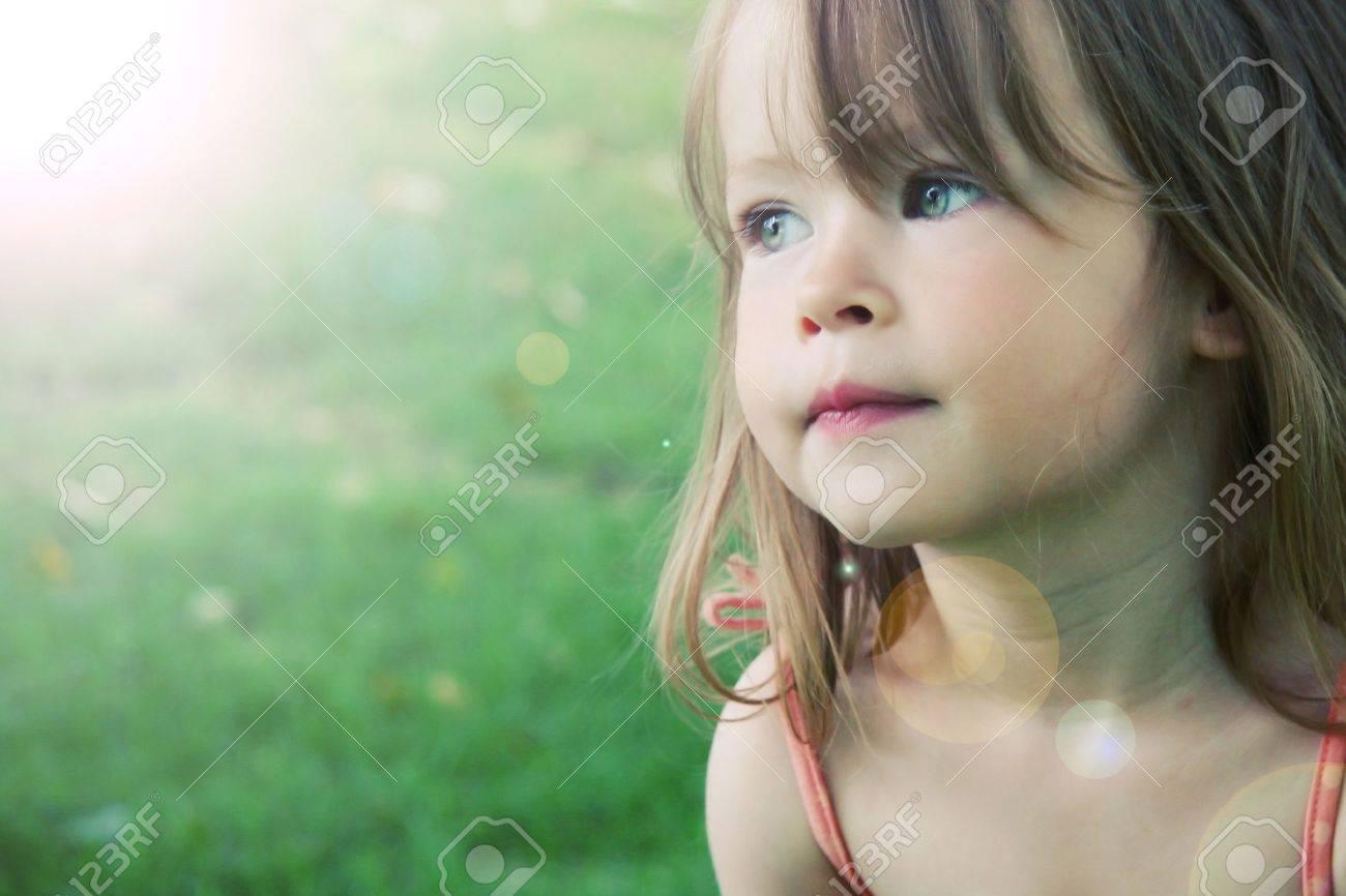 Adorable little girl taken closeup outdoors in summer - lighting effect - 7111803