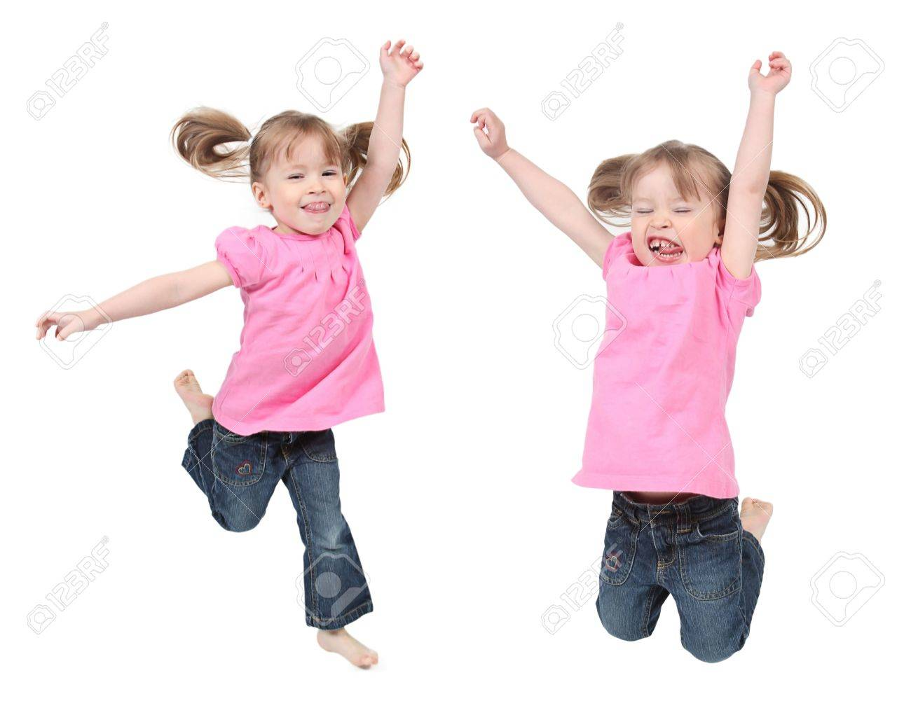 Adorable and happy little girls jumping in air. isolated on white background - 8810191