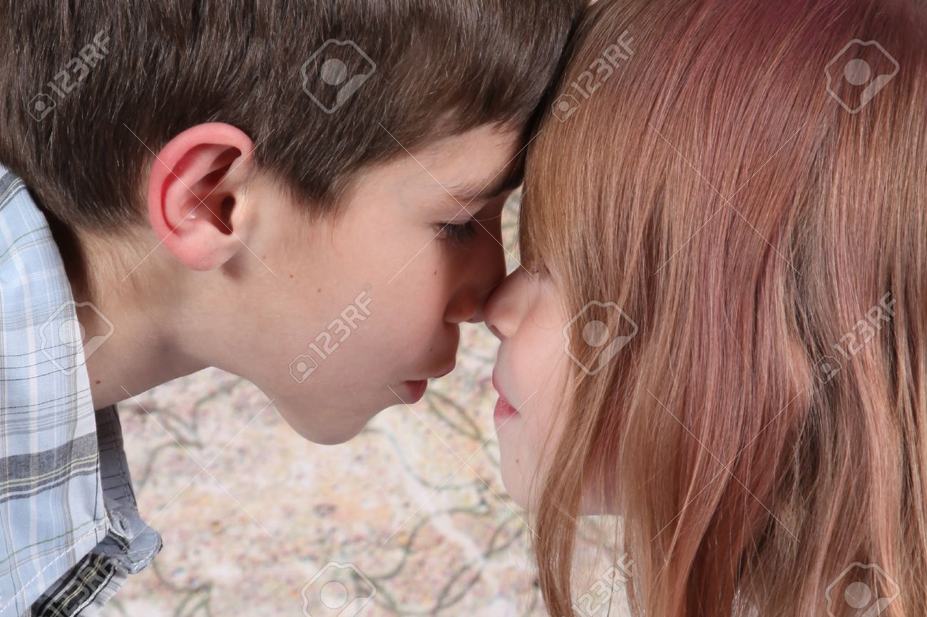 Girls kissing each other in bed