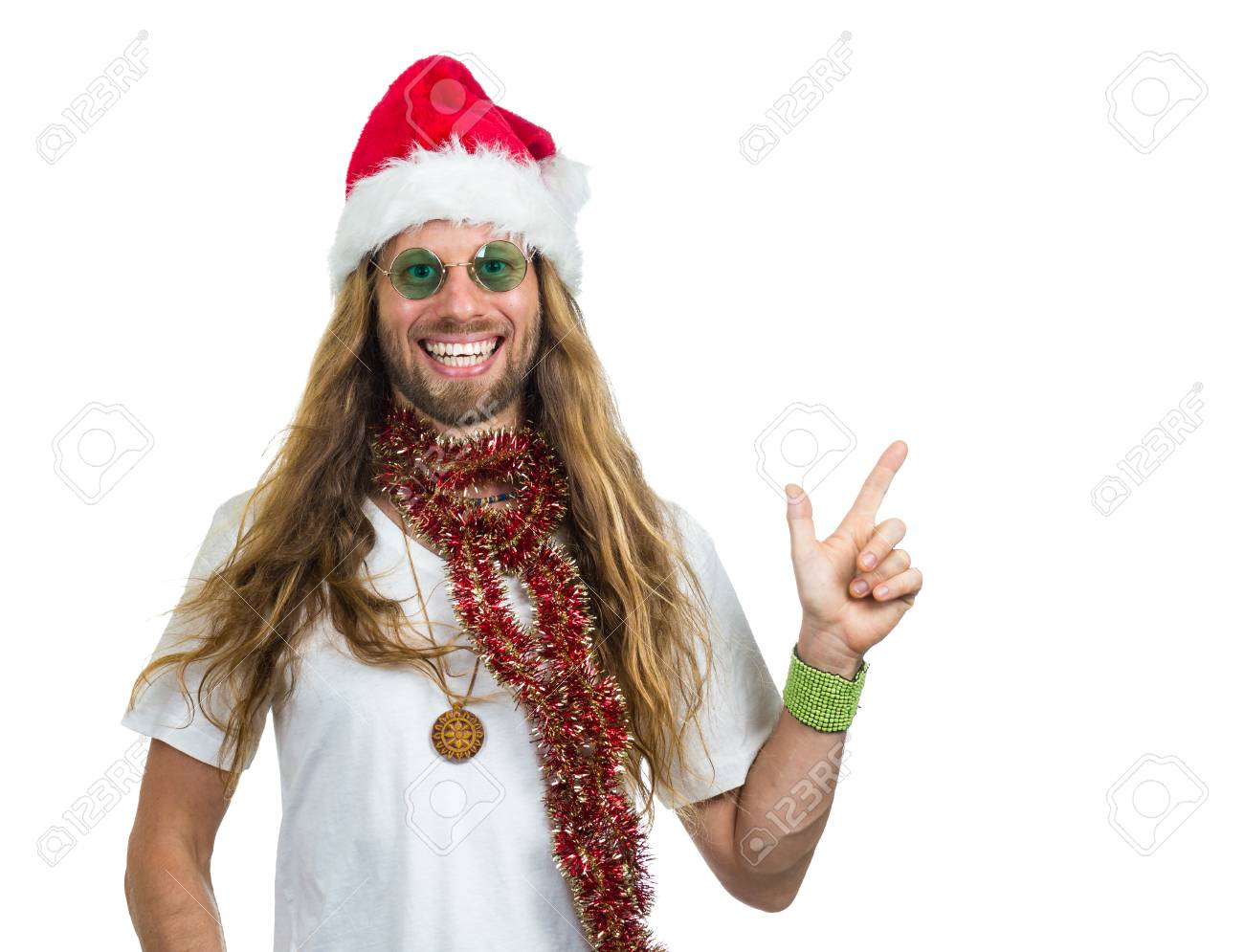 Smiling hippie in Santa hat pointing at copy-space Isolated on white  background Stock Photo 6f7c65708c4