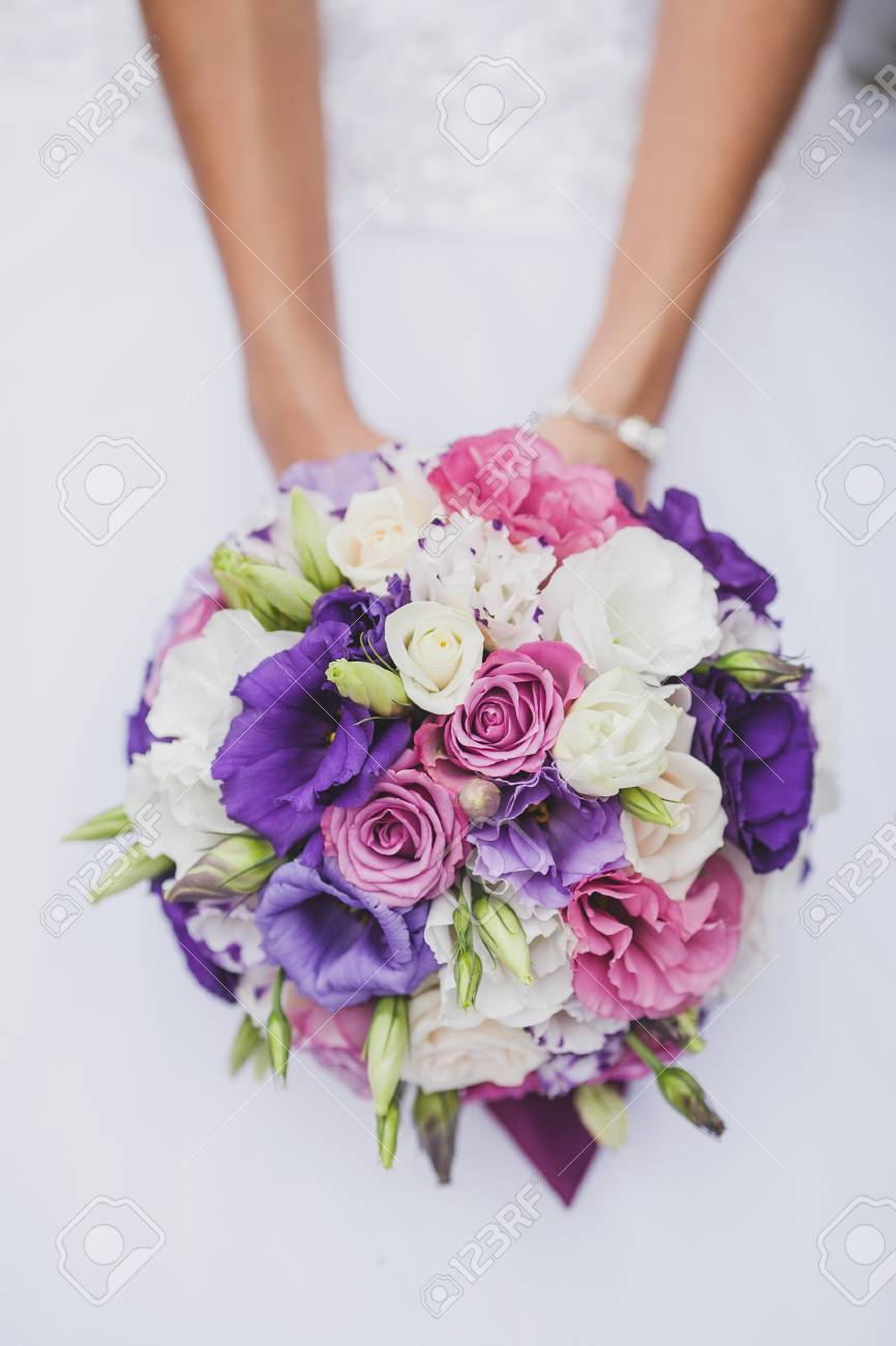 Bride In A White Wedding Dress Holding A Flowers Bouquet From ...