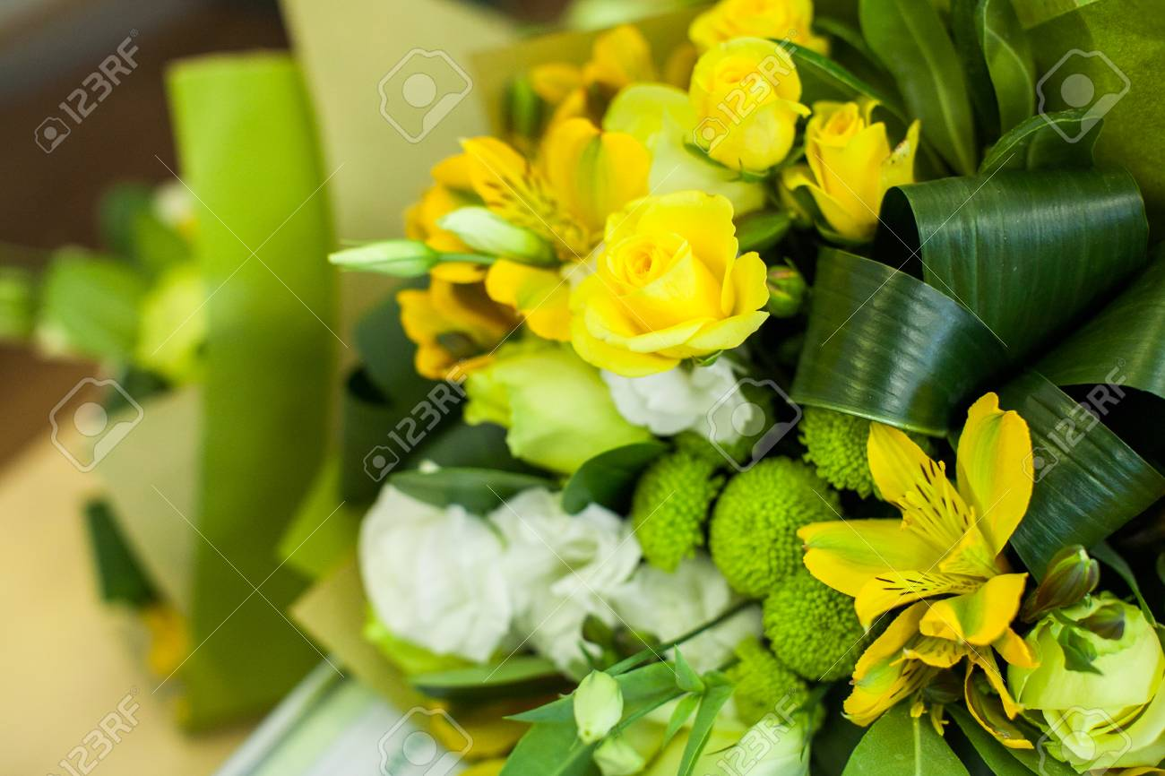 Green And Yellow Flower Composition On A Table Wedding Decor