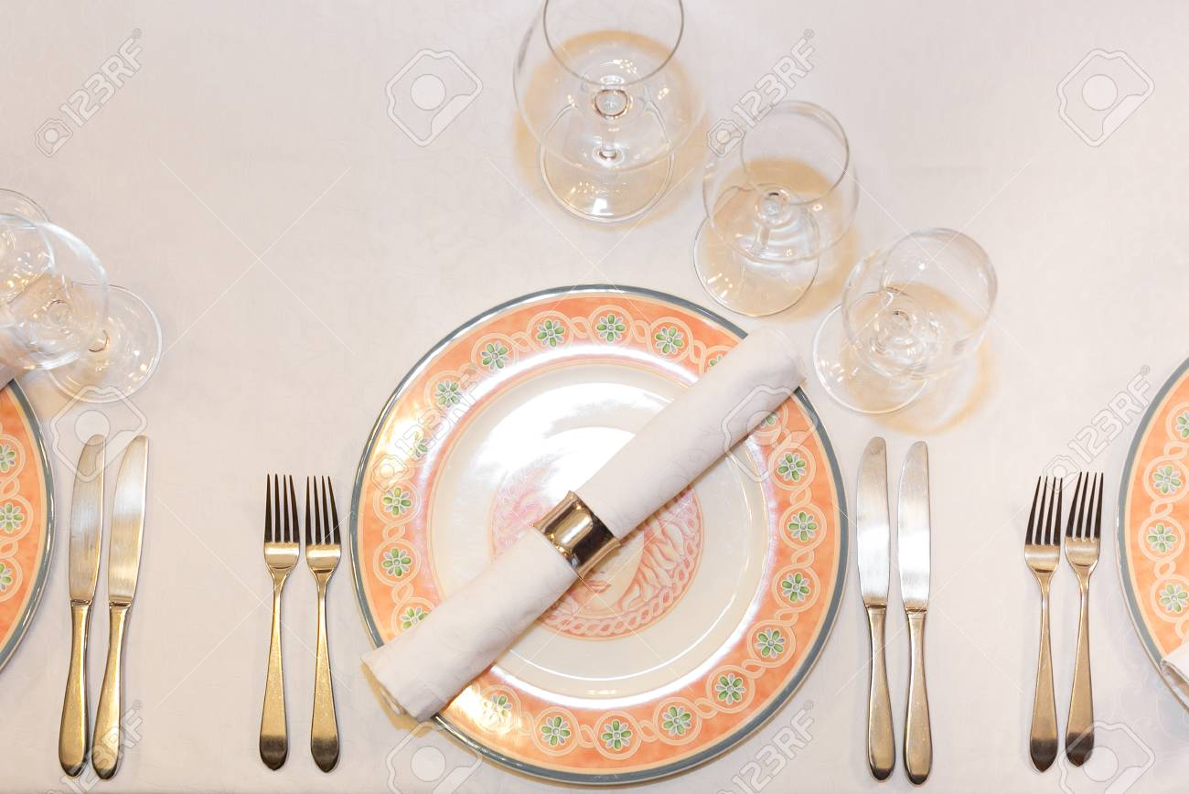 Stock Photo - Tableware catering design concept. Top view of served place of restaurant with flat plate decorated by floral patterns set of silverware ... & Tableware Catering Design Concept. Top View Of Served Place ...