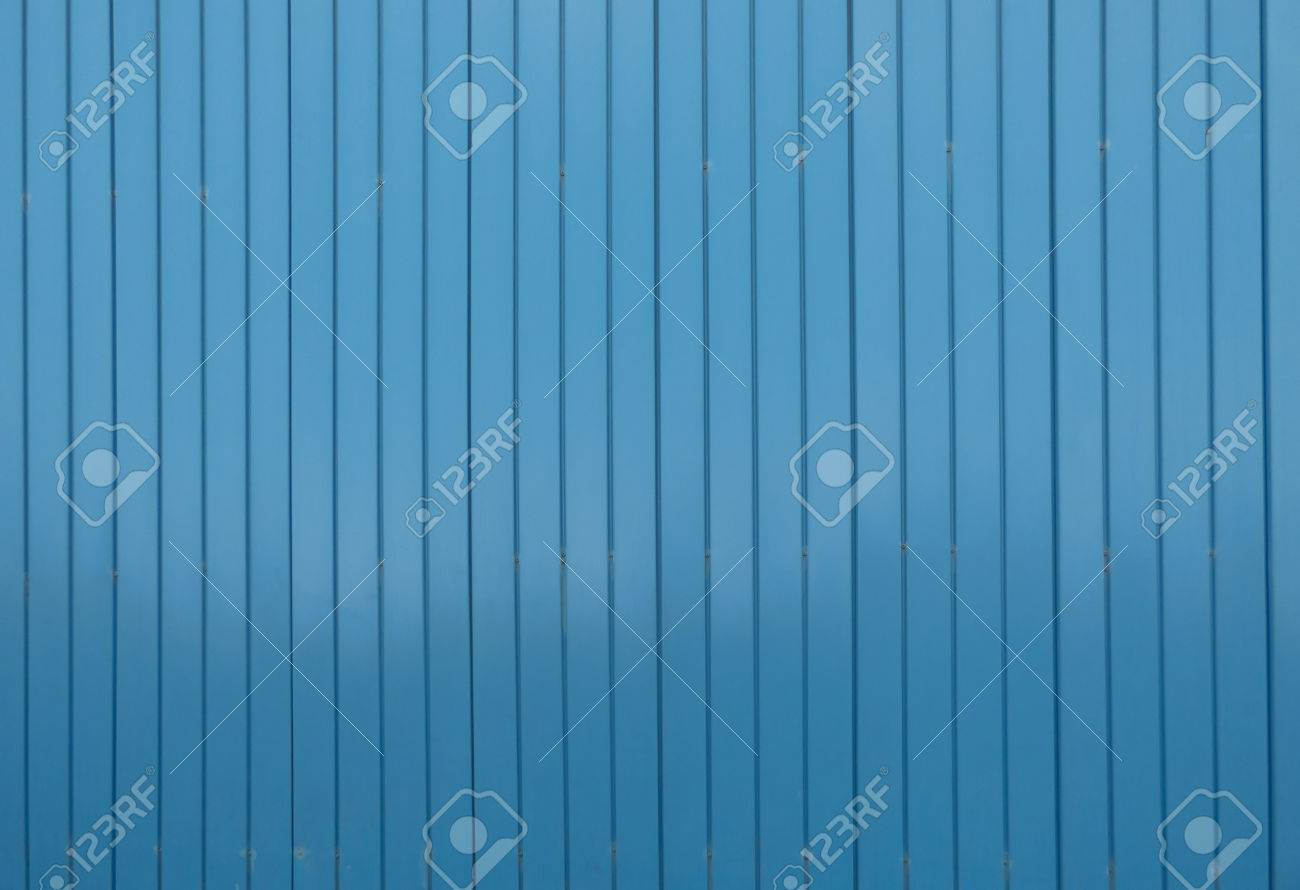 Large blue metal siding wall texture with vertical structure