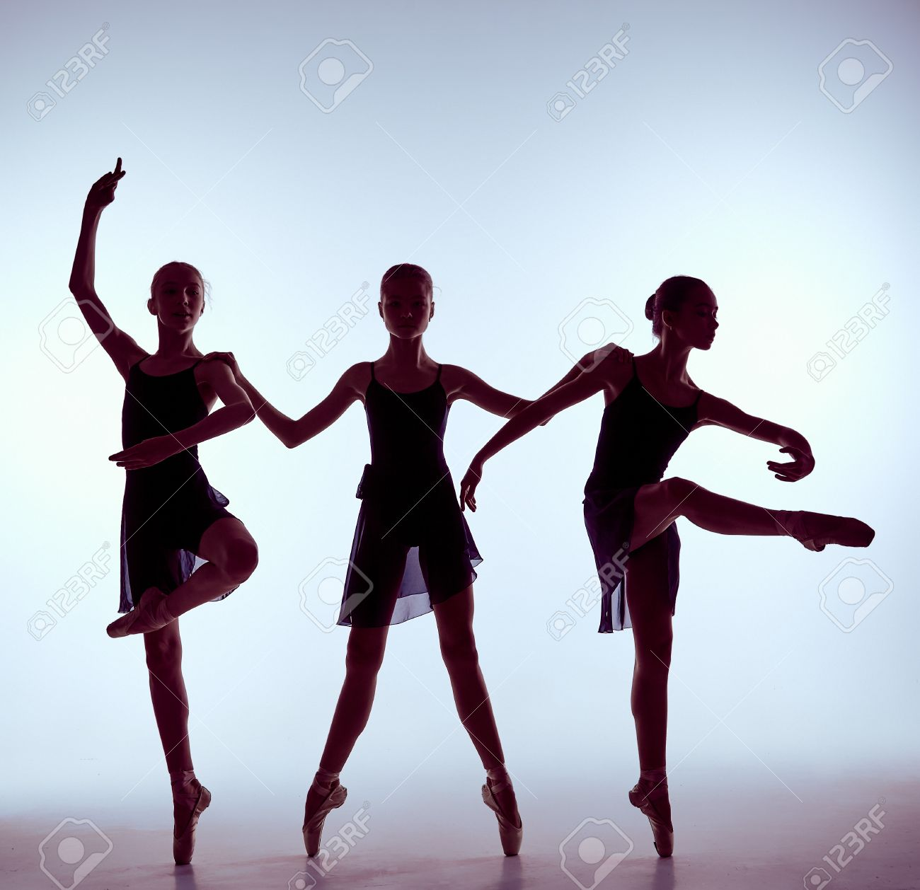Silhouettes Of Three Young Dancers In Ballet Poses On A Gray Stock Photo Picture And Royalty Free Image Image 40507305