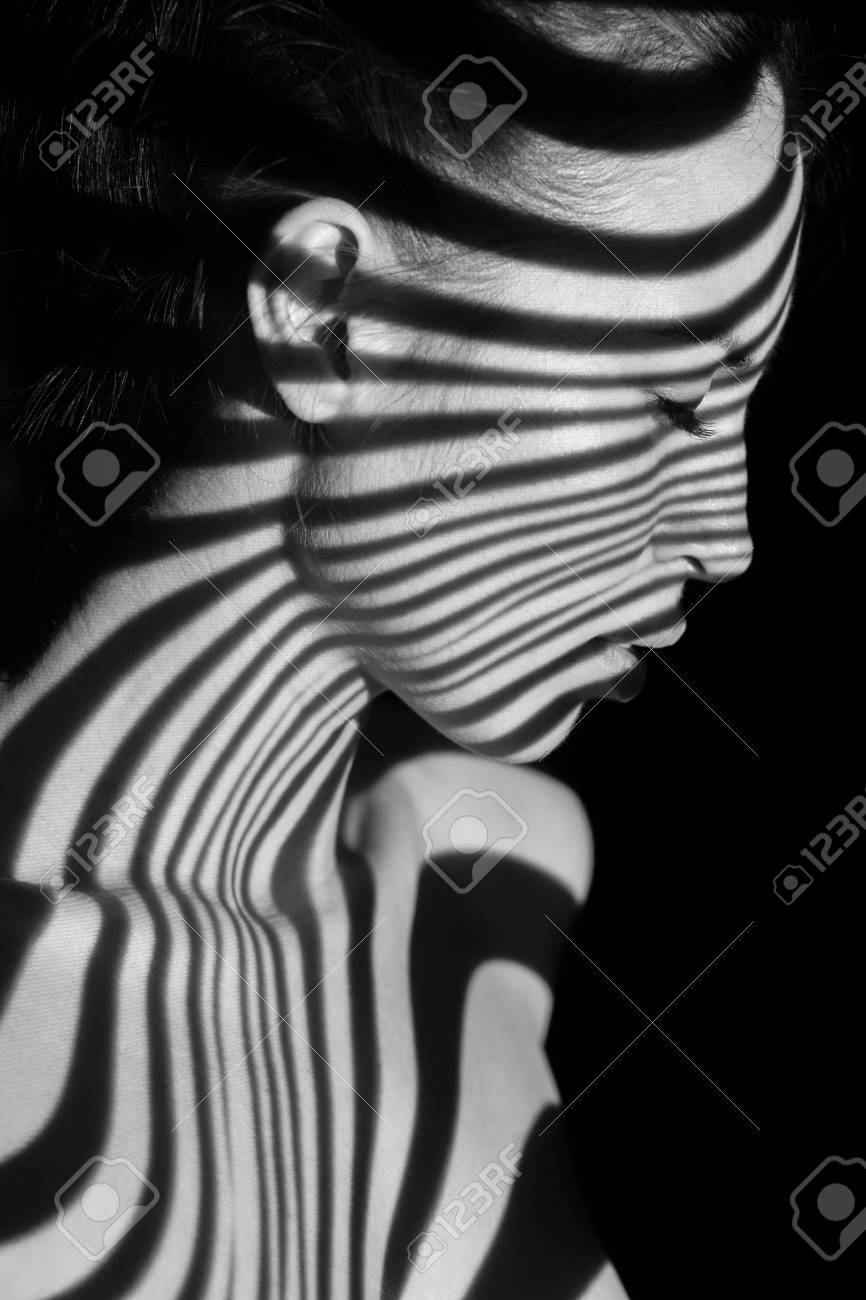 Stock photo the face of nude woman with black and white zebra stripes black and white photo created with the projector