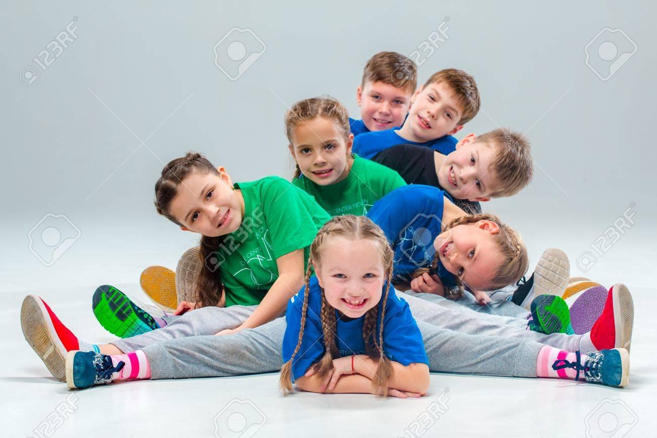 The kids dance school, ballet, hiphop, street, funky and modern dancers on gray studio background - 67742147