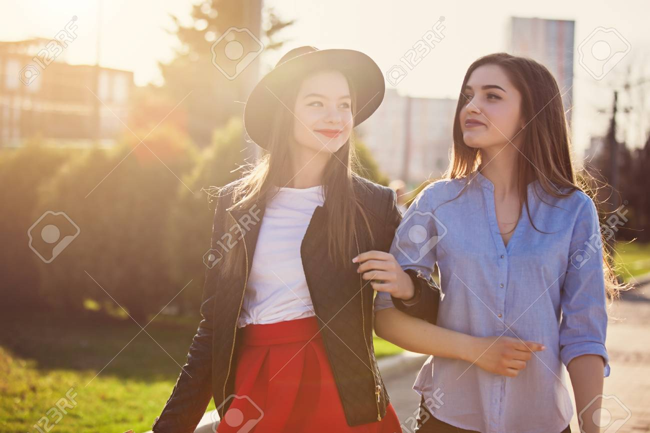 Two Girls Walking With Shopping On City Streets Stock Photo Picture