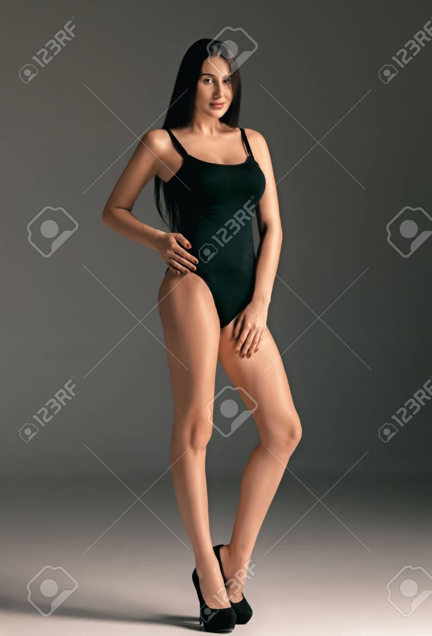 2b54ac1a6 Fashion Woman Portrait. Beautiful Teen Model In A Black Swimsuit ...