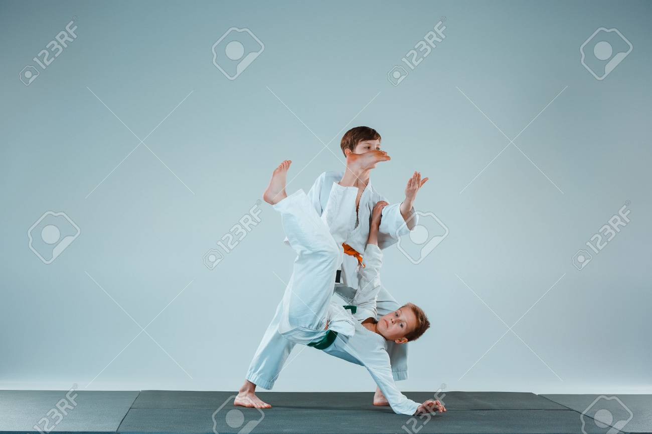 20e589e52a8ef Stock Photo - The two boys fighting at Aikido training in martial arts  school. Healthy lifestyle and sports concept