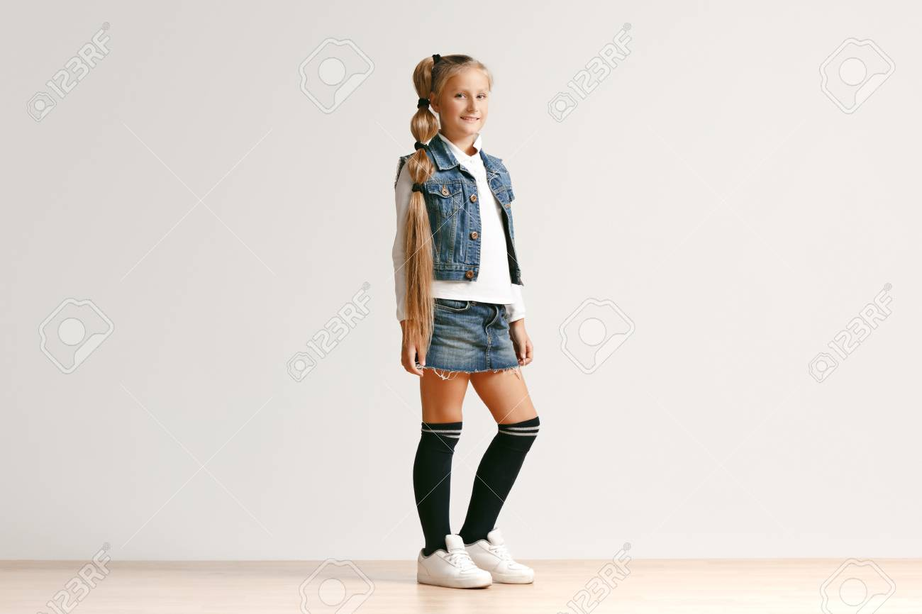 Full Length Portrait Of Cute Little Teen Girl In Stylish Jeans Stock Photo Picture And Royalty Free Image 112674722