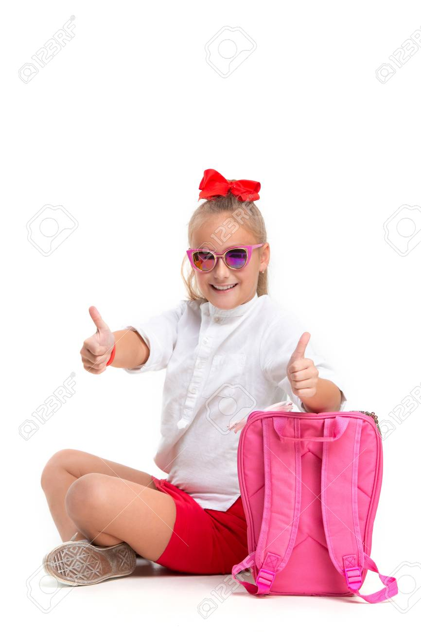 c363c201ef9e Full length portrait of cute little kid girl in stylish sunglasses looking  at camera and smiling