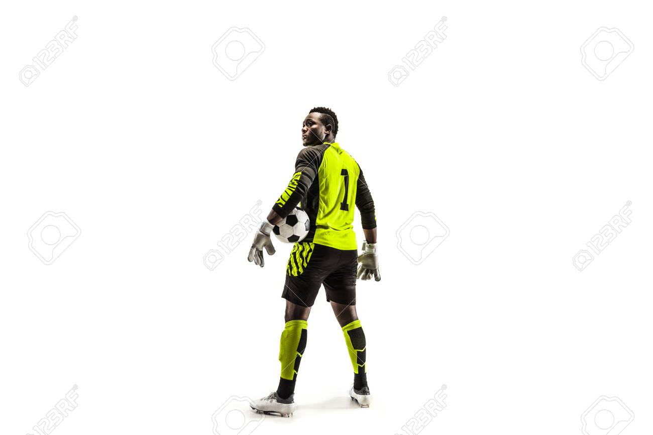 One african male soccer player goalkeeper standing and holding ball. Silhouette isolated on white studio background - 117219027