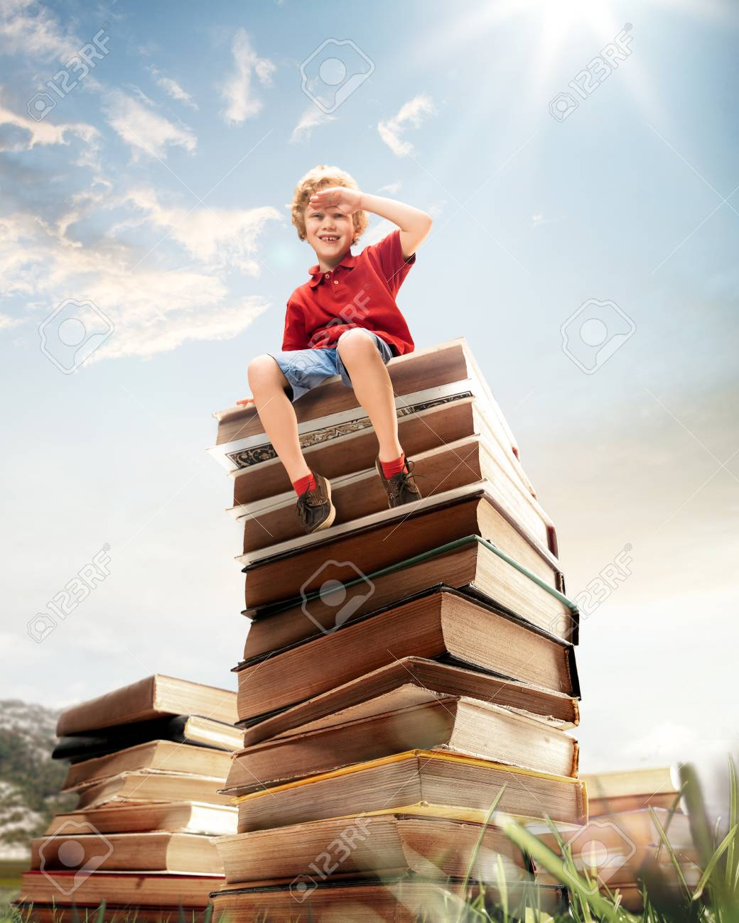 Little boy sitting on the tower made of big books. Childhood dreams, reading and education concept. Wondering world. abstract collage - 117841119