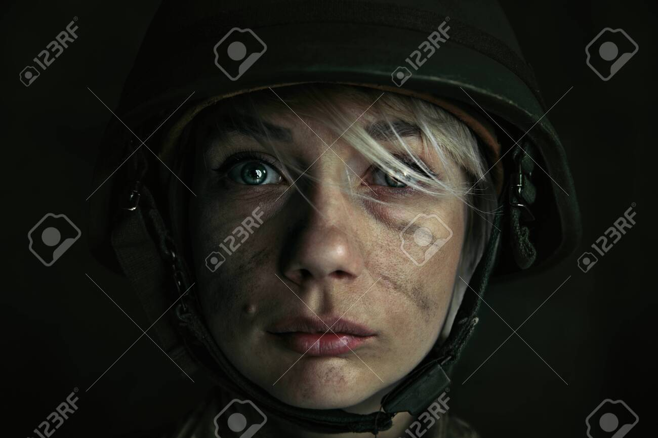 Only one chance to be alive. Close up portrait of young female soldier. Woman in military uniform on the war. Depressed and having problems with mental health and emotions, PTSD. - 121063155