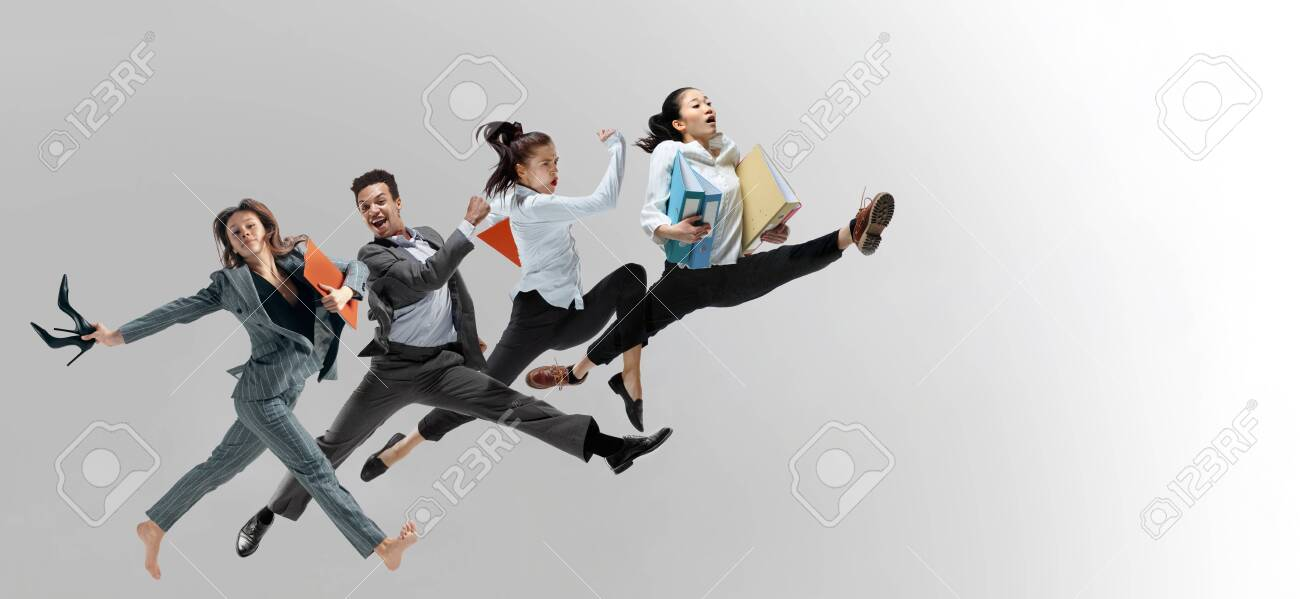 Happy office workers jumping and dancing in casual clothes or suit with folders isolated on studio background. Business, start-up, working open-space, motion and action concept. Creative collage. - 124483307