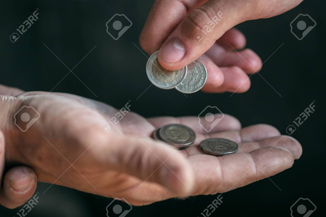 Male beggar hands seeking money, coins from human kindness on the wooden floor at public path way or street walkway. Homeless poor in the city. Problems with finance, place of residence. - 124598499