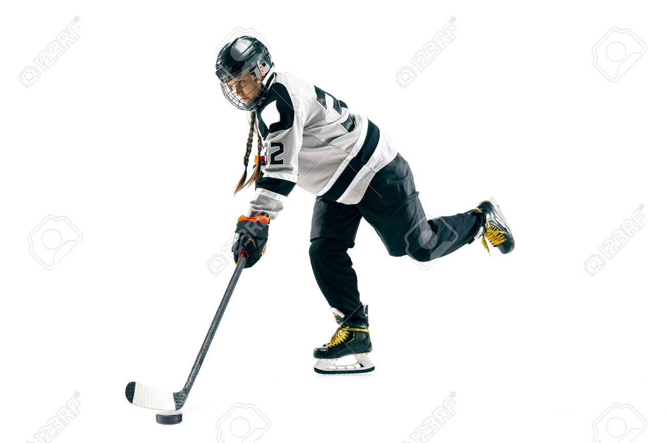 Young female hockey player with the stick isolated on white background. Sportswoman in action wearing equipment attacking for the goal or score. Concept of sport, healthy lifestyle, motion, movement. - 125503237