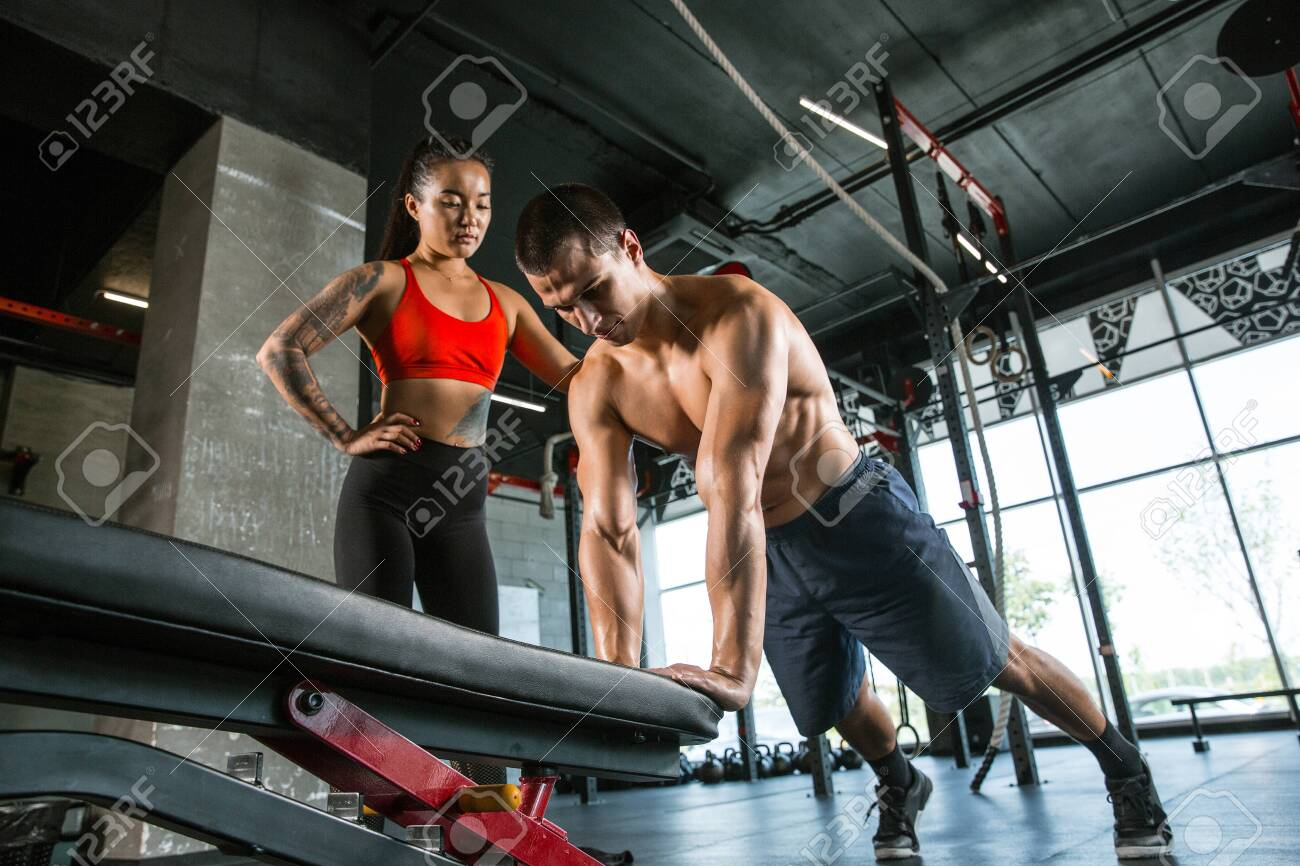 A Muscular Athletes Doing Workout At The Gym Gymnastics Training Stock Photo Picture And Royalty Free Image Image 128871730