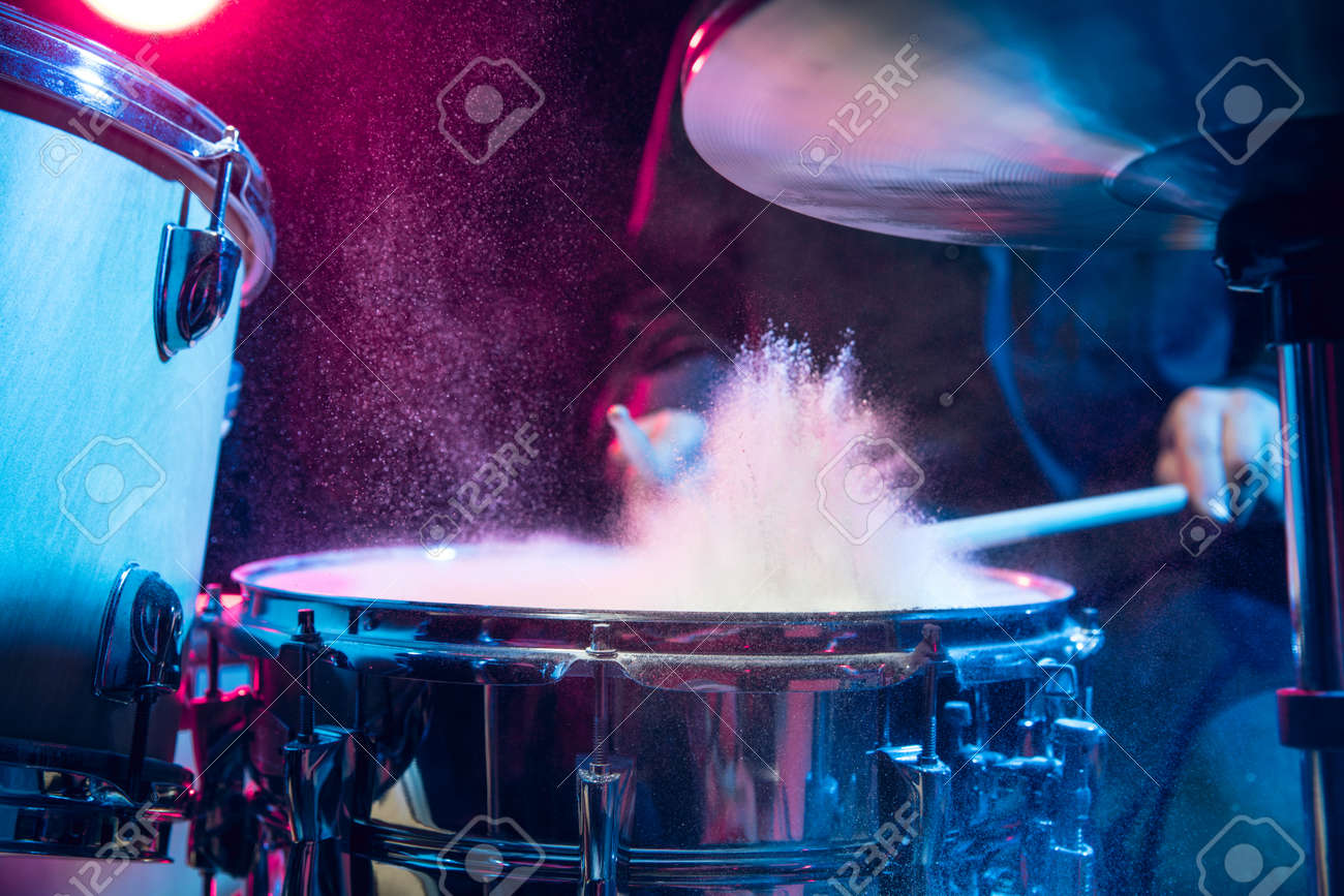 Drummers rehearsing on drums before rock concert. Man recording music on drumset in studio - 166876583