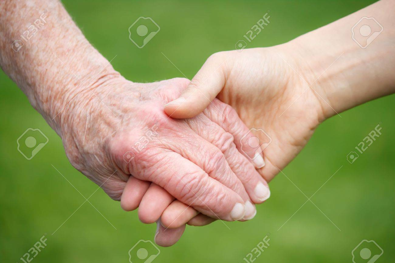 Senior and Young Women Holding Hands Stock Photo - 9535605