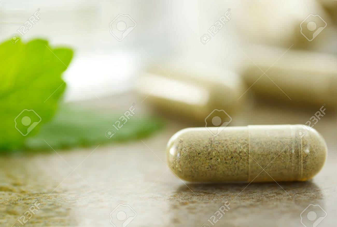 Close up of herbal medicine in capsules - 9877319