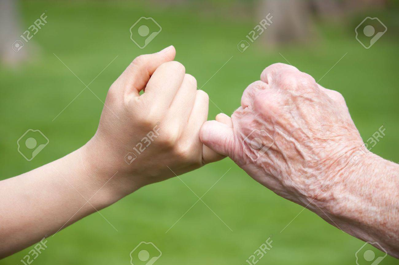 Senior and Young Hands Promise Stock Photo - 10010430