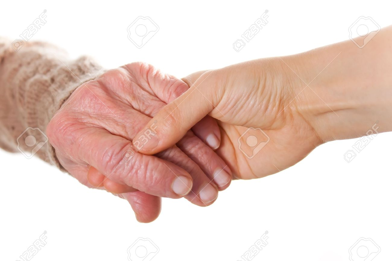 Image result for old hands holding young hands stock photo