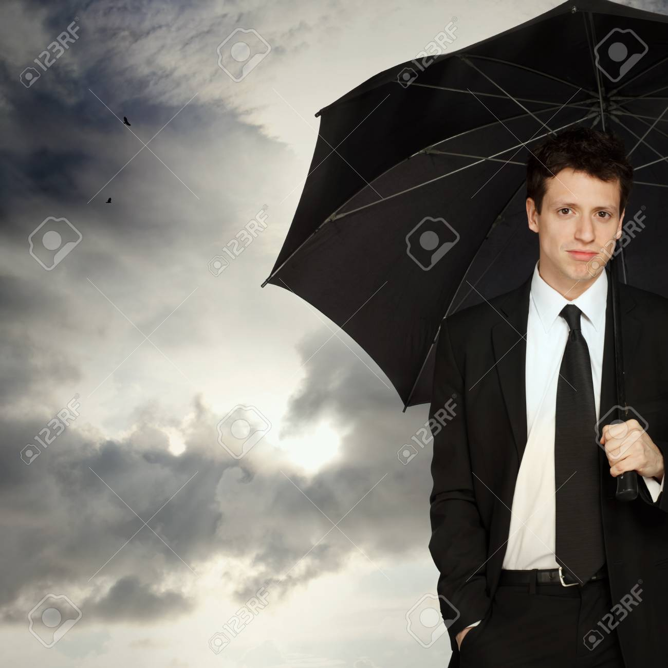 Portrait of a Young Stylish Business Man with Umbrella Stock Photo - 13123831