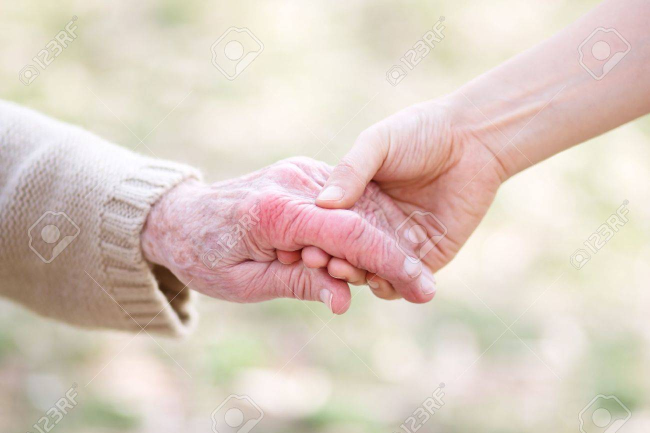 Senior lady and young women holding hands Stock Photo - 13562147