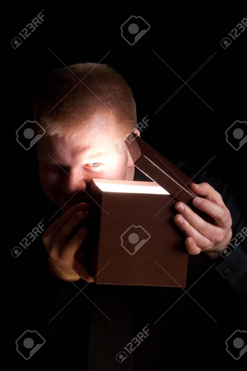 Man Opening a Shinning Present Box Stock Photo - 13636576