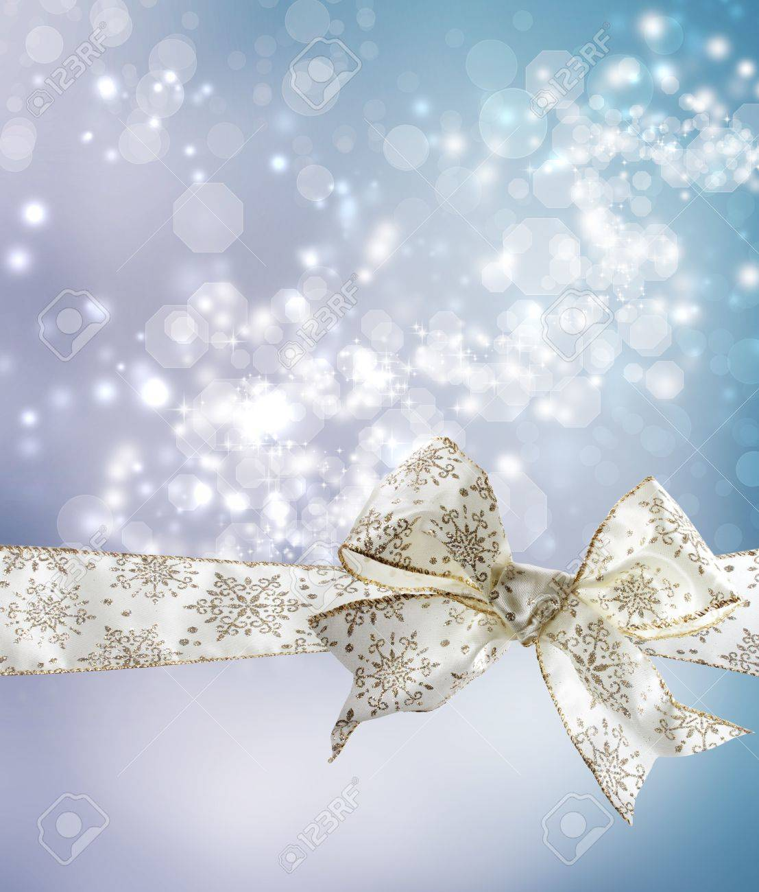 White Snowflake Bow and Ribbon with Bokeh Lights Background Stock Photo - 16552517