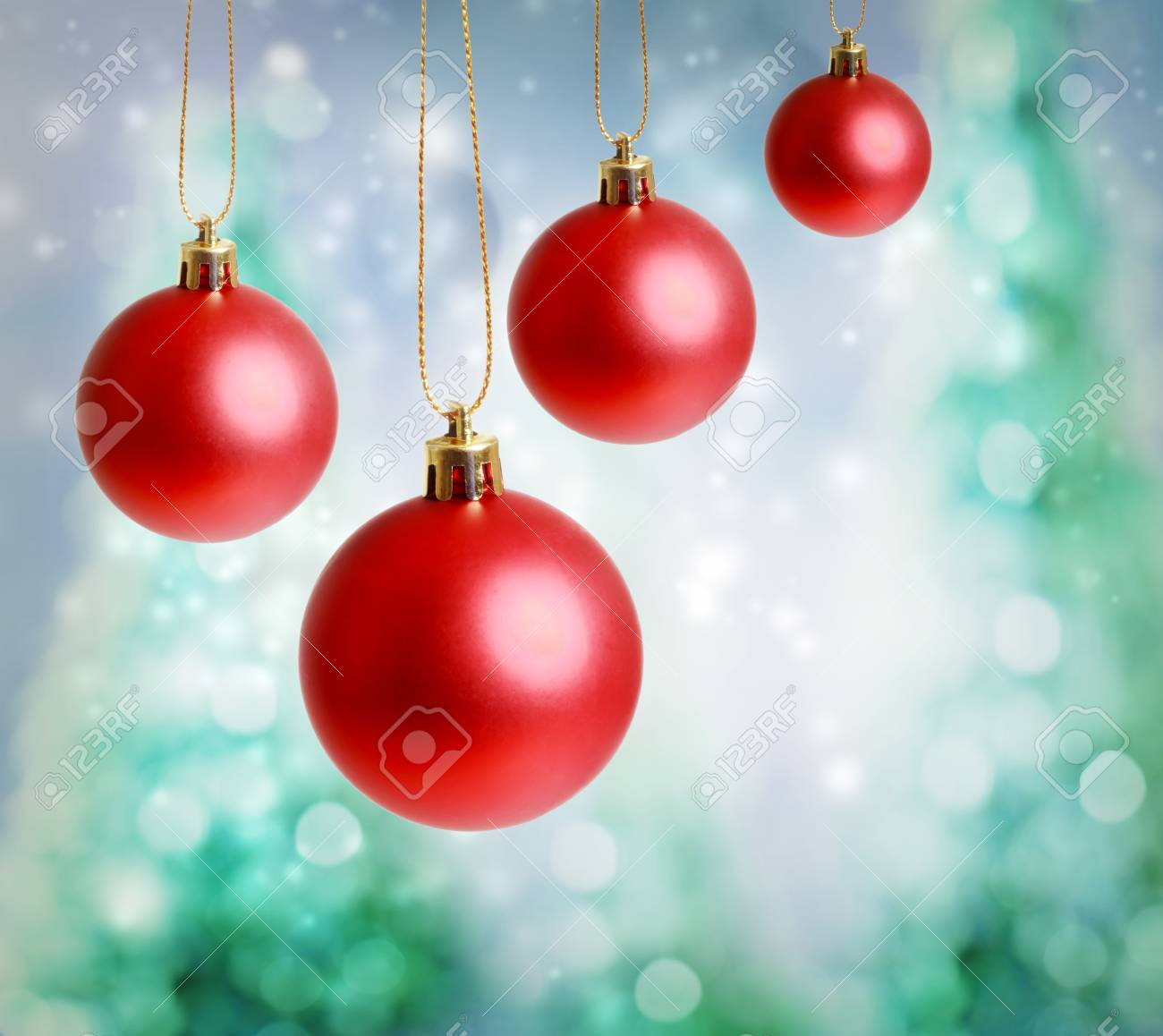Red Christmas ornaments with green-blue Christmas tree lights background Stock Photo - 16630429