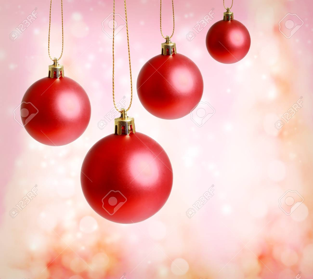 Red christmas ornaments with pink lights background Stock Photo - 16630424