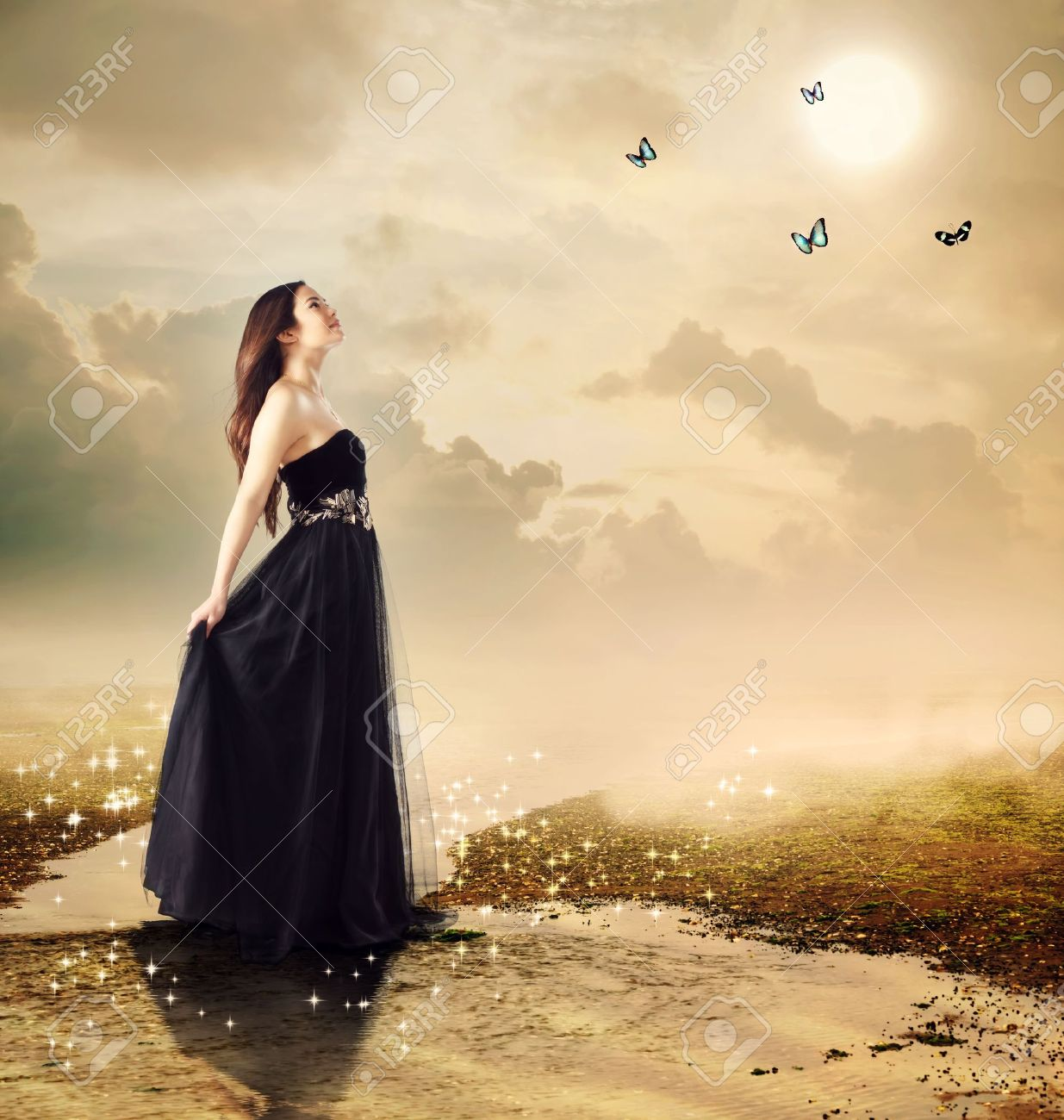 Beautiful girl at a brook under the moon light (with butterflies) Stock Photo - 17640459